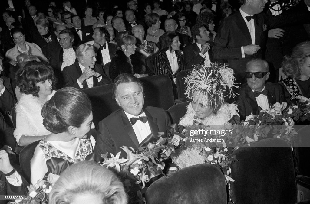 Maria Callas, Greek Opera singer (1923-1977), the british actor Richard Burton and the american actress Liz Taylor at the reception for the 75th birthday of the famous french restaurant Maxim's in Paris, 19th October 1968