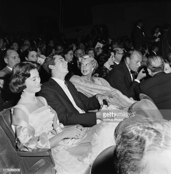 From left to right, Maria Cooper, Anthony Perkins, Veronica 'Rocky' Cooper and Gary Cooper at the premiere of the film 'The Spirit of St Louis' in...