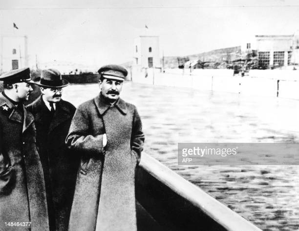 Marshal Kliment Voroshilov Chairman of the council of People's Commissars Vyacheslav Molotov General Secretary of the PCUS Joseph Stalin pose at the...