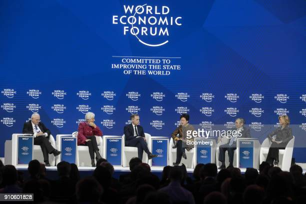 From left to right Martin Wolf journalist at the Financial Times Christine Lagarde managing director of the International Monetary Fund Mark Carney...