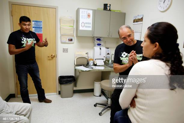 From left to right Medical Assistant Genaro Jimenez translates Dr Daniel Sloane's question to Maria Granados inside the Mattawa Community Medical...