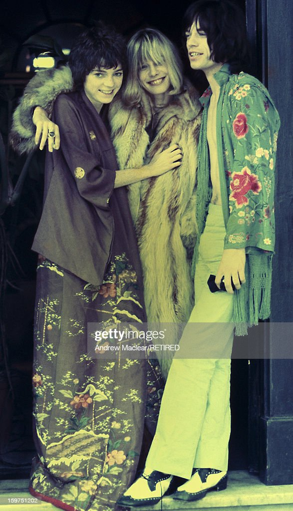From left to right, Michèle Breton, Anita Pallenberg and Mick Jagger on the set of Donald Cammell and Nicolas Roeg's psychological thriller 'Performance', UK, 1968.