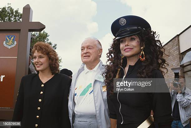 From left to right Miss Universe Mona Grudt entertainer Bob Hope and singer LaToya Jackson at RAF Mildenhall in Sussex May 1990 They are putting on a...