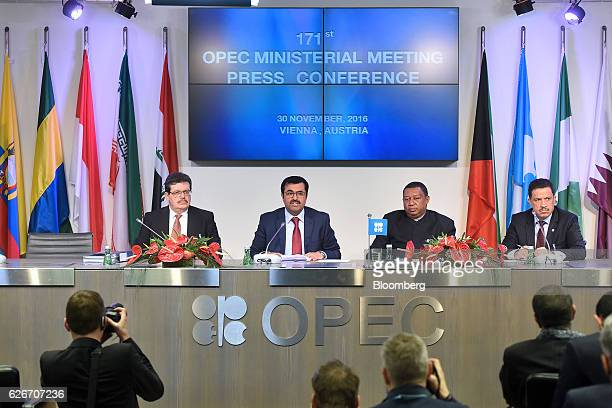 From left to right Mohamed Hamel chairman of OPEC Mohammed AlSada Qatar's minister of energy and industry and president of OPEC Mohammed Barkindo...