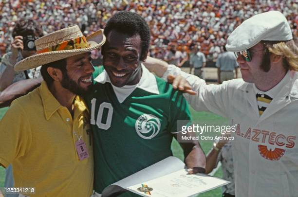 From left to right, musician Sergio Mendes, soccer player Pelé of the New York Cosmos and singer Elton John in Los Angeles, before the start of a...