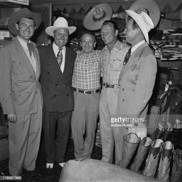 From left to right, musician Tex Williams , actor and singer Gene Autry , tailor Nudie Cohn , actor and singer Roy Rogers and singer Rex Allen at a...