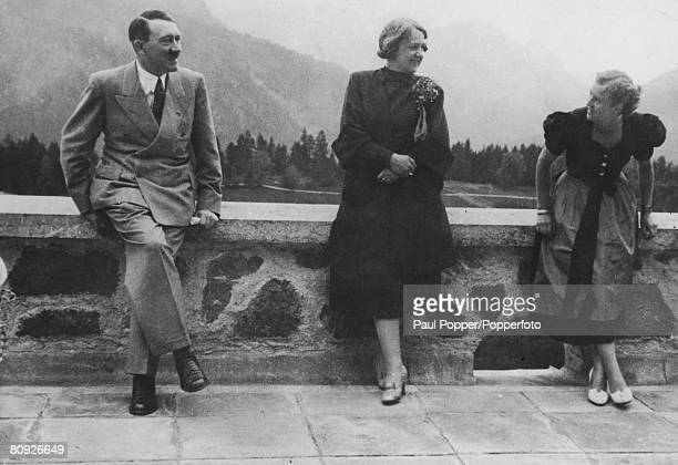 From left to right, Nazi leader Adolf Hitler with Johanna Morell, the wife of his personal physician, and Eva Braun , at the Berghof, circa 1937.
