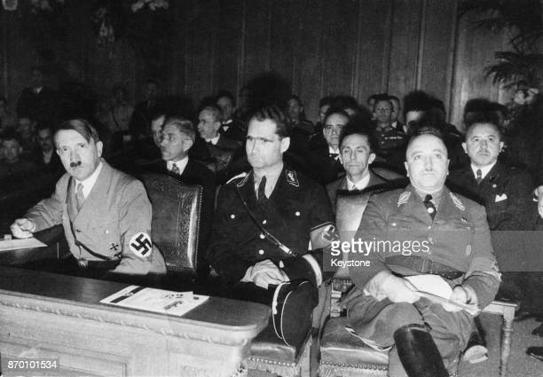 From left to right Nazi Party officials Adolf Hitler Rudolf Hess and Robert Ley at the first Congress of National Labour in the chamber of the...