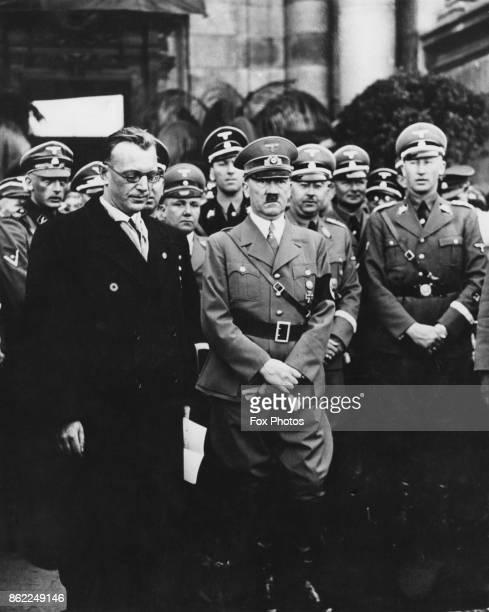 From left to right Nazi politicians Arthur SeyssInquart Adolf Hitler Heinrich Himmler and Reinhard Heydrich in Vienna Austria 15th March 1938