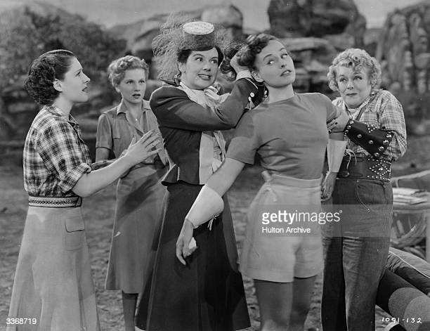 From left to right Norma Shearer Joan Fontaine Rosalind Russell Paulette Goddard and Mary Boland in a scene from 'The Women' a film about a group of...