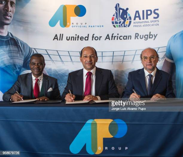 From left to right Obi Mitchell president of AIPS Africa Nicolas PompigneMognard Founder CEO of APO group and Gianni Merlo President of AIPS signing...