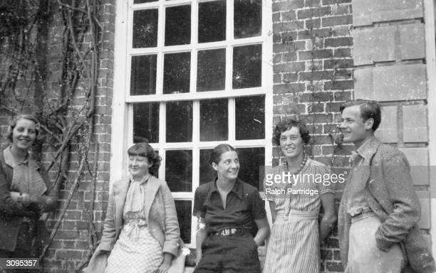 From left to right Pamela Mitford Julia Strachey Mrs Cohen Frances Partridge and Bryan Guinness at Biddesden home of the Moyne family