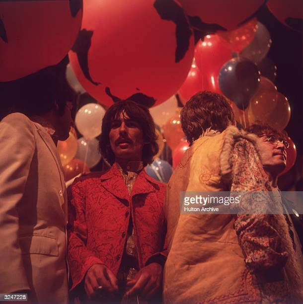 From left to right Paul McCartney George Harrison Ringo Starr and John Lennon of the Beatles surrounded by floating coloured balloons They are at the...