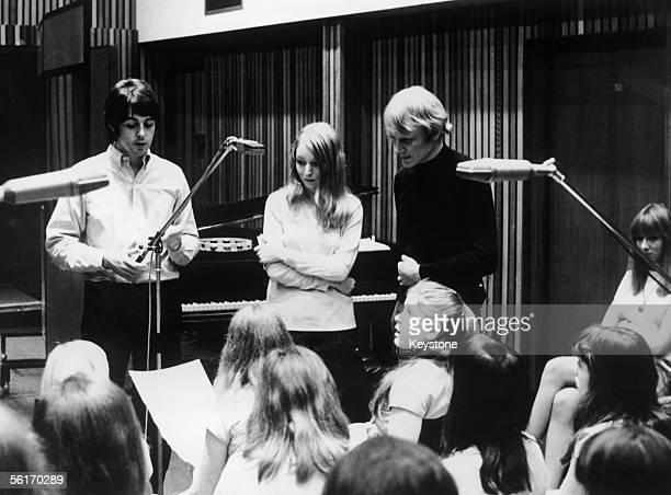 From left to right Paul McCartney Mary Hopkin and arranger Richard Newson enlist the aid of the Aida Foster Children's Choir to record Hopkin's song...