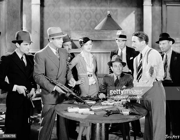 From left to right Paul Muni Karen Morley George Raft and Osgood Perkins star in the gangster film 'Scarface' directed by Richard Rosson and Howard...