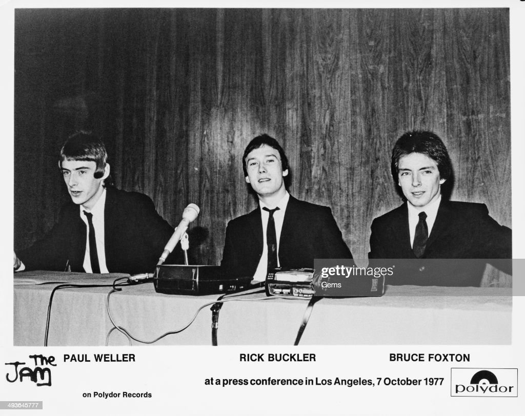 From left to right, Paul Weller, Rick Buckler and Bruce Foxton of The Jam at a press conference in Los Angeles, 7th October 1977.