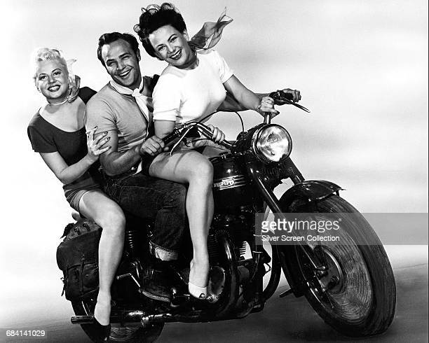 From left to right Peggy Maley as Mildred Marlon Brando as Johnny Strabler and Yvonne Doughty as Britches in a promotional still for the film 'The...