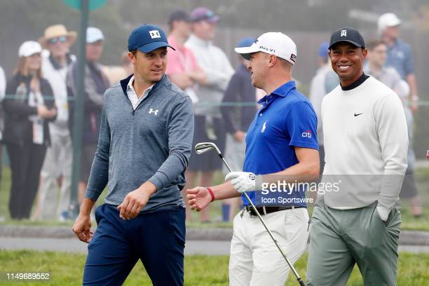 From left to right PGA golfers Jordan Spieth and Justin Thomas and Tiger Woods walk the 16th hole during a practice round for the 2019 US Open on...