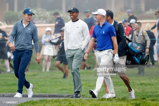 From left to right PGA golfers Jordan Spieth and Tiger Woods and Justin Thomas walk the 16th hole during a practice round for the 2019 US Open on...
