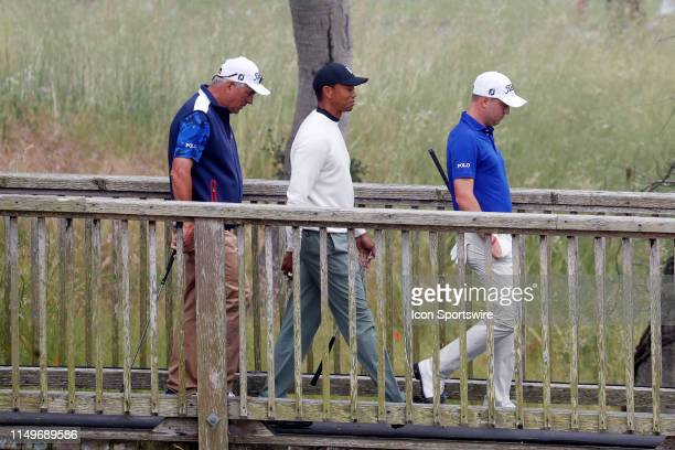From left to right PGA golfers Tiger Woods and Justin Thomas walk the 16th hole during a practice round for the 2019 US Open on June 12 at Pebble...