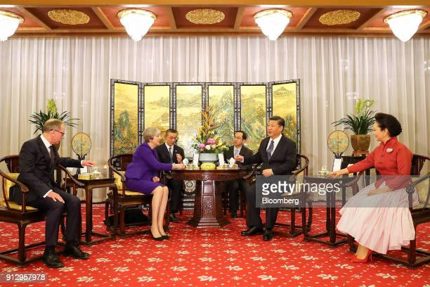 From left to right Philip May husband of UK Prime Minister Theresa May Theresa May UK prime minister Xi Jinping China's president and Peng Liyuan...