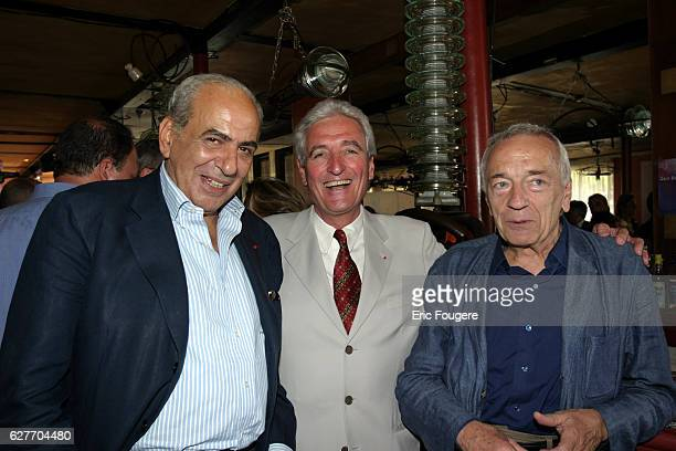 Pierre Benichou Jean Loup Dabadie and Jean Pierre Cassel attend the ceremony during which cooking specialist JeanLuc Petitrenaud became Chevalier de...