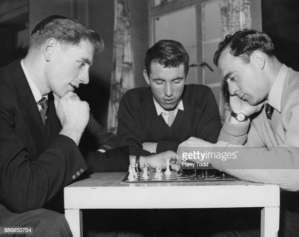 From left to right, Portsmouth footballers Fred Brown , Willie Morrison and Ron Saunders relax with a game of chess at their hotel in Saltdean, UK,...
