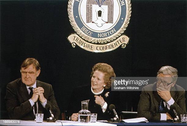 From left to right press secretary Bernard Ingham UK Prime Minister Margaret Thatcher and Foreign Secretary Geoffrey Howe at Brize Norton England 7th...