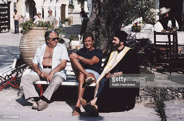 From left to right producer Albert R Broccoli English actor Roger Moore and producer and screenwriter Michael G Wilson on the set of the James Bond...