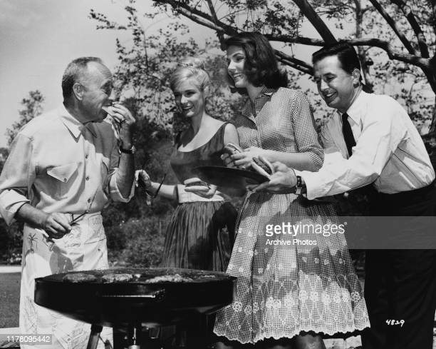 From left to right producer Joe Pasternak hosts a wrap party barbecue for the stars of his latest MGM film 'Where the Boys Are' at his Bel Air estate...