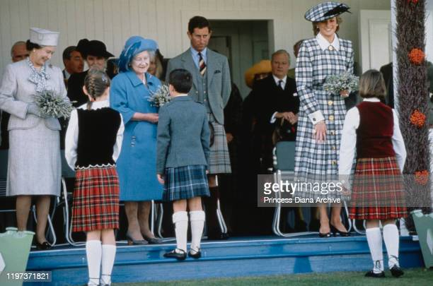 From left to right, Queen Elizabeth II, the Queen Mother, Prince Charles and Diana, Princess of Wales at the Braemar Games, a Highland Games...