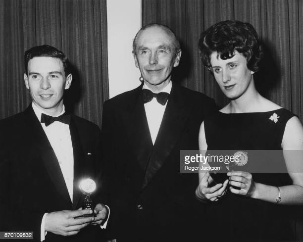 From left to right racing driver Jim Clark British Prime Minister Alec DouglasHome and sprinter Dorothy Hyman at the annual dinner of the Sport...