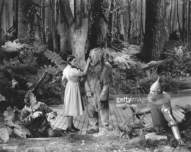 From left to right Ray Bolger as the Scarecrow Judy Garland as Dorothy Bert Lahr as the Cowardly Lion and Jack Haley as the Tin Man in the MGM film...