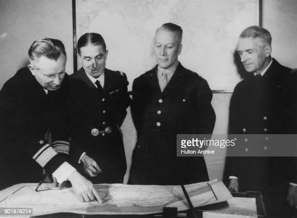 From left to right Rear Admiral A C Bennett of the US Navy General Alain de Boissieu of the French African Army MajorGeneral Lloyd Fredendall of the...