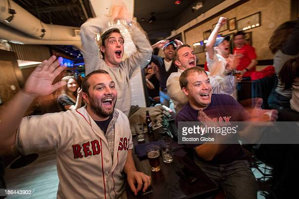 From left to right Red Sox fans Ben Blum Dan Gommel Chris Blum and Pat Hitchcock react at Forum in Boston as Jacoby Ellsbury escapes a rundown during...