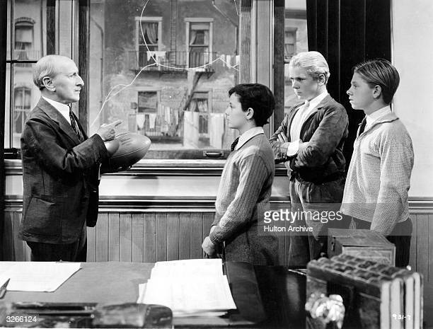 From left to right renowned child actors Freddie Bartholomew Jackie Cooper and Mickey Rooney get a severe tellingoff in a story of juvenile...