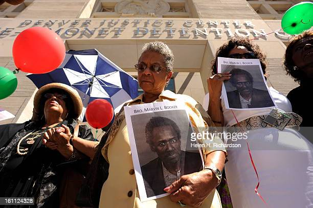 From left to right Reverand Carolyn Smith Jean Brodnax and Barbara Moore pray together during the rally Dr Timothy E Tyler and members of the Shorter...