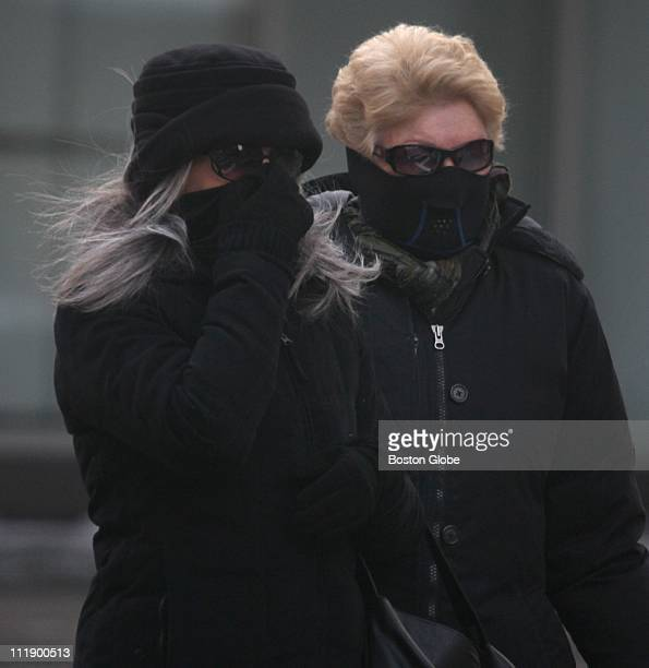 From left to right Rhonda Davidson and Pat Rivera both visiting from California try to stay warm on Boylston Street as a blast of subfreezing...