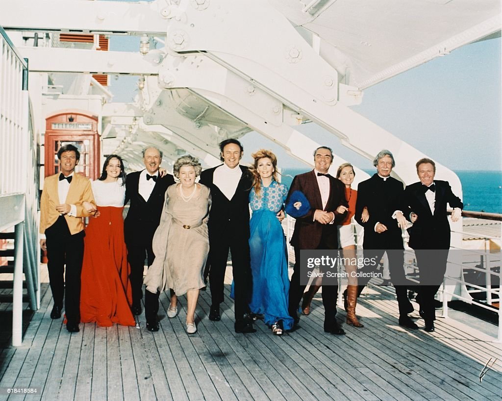 From left to right, Roddy McDowall, Pamela Sue Martin, Jack Albertson, Shelley Winters, Gene Hackman, Stella Stevens, Ernest Borgnine, Carol Lynley, Arthur O'Connell and Red Buttons, the cast of the disaster movie 'The Poseidon Adventure', on the deck of a liner, 1972.