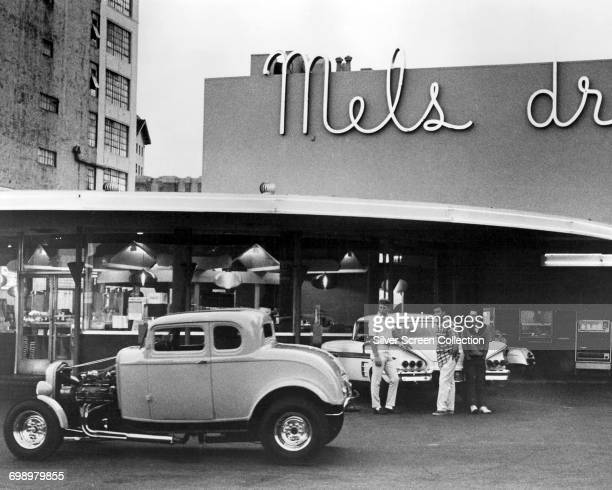 From left to right Ron Howard as Steve Bolander Richard Dreyfuss as Curt Henderson and Charles Martin Smith as Terry outside Mel's DriveIn diner in...