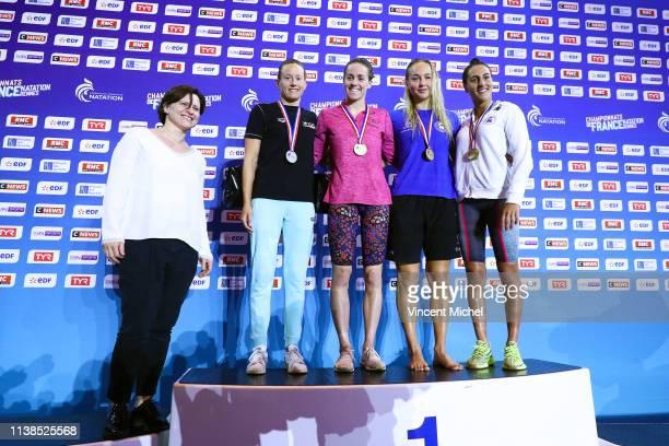 Roxana Maracineanu French Minister of Sports Aurelie Muller Lara Grangeon Ana Egorova and Oceane Cassignol on the poidum of the 800m freestyle women...