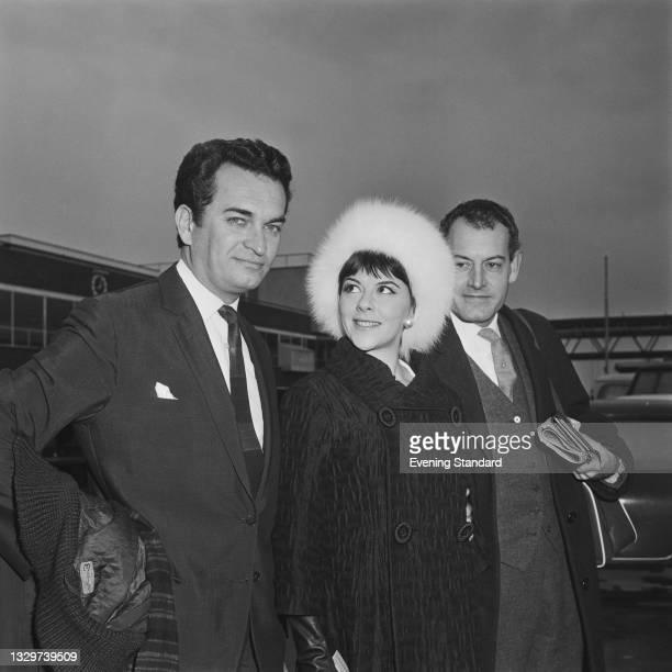 From left to right Royal Shakespeare Company actors Derek Godfrey , Dorothy Tutin and Tony Church at London Airport, UK, 18th November 1964. They are...