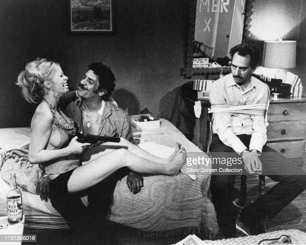 From left to right Sally Struthers as Fran Clinton Al Lettieri as Rudy Butler and Jack Dodson as Harold Clinton in the film 'The Getaway' 1972