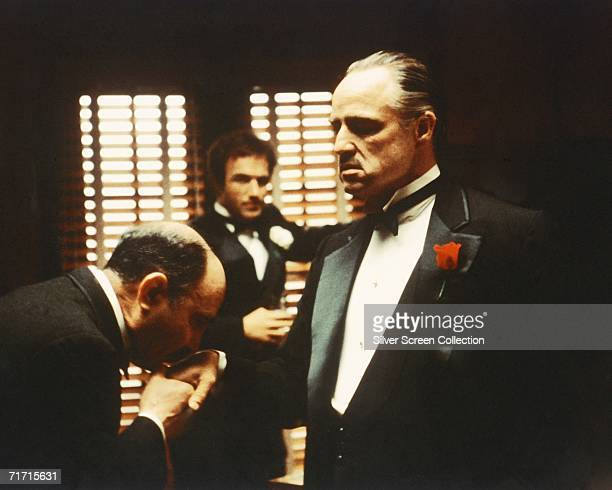 From left to right Salvatore Corsitto as Bonasera James Caan as Santino 'Sonny' Corleone and Marlon Brando as Don Vito Corleone in 'The Godfather'...