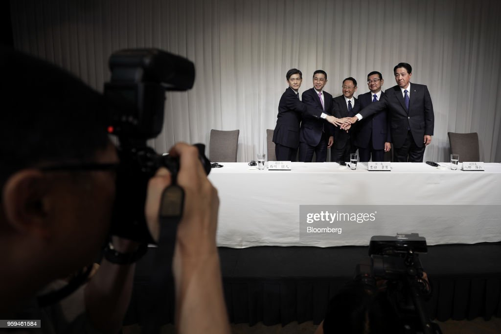 From left to right, Seiichi Nagatsuka, president and vice chairman of Japan Automobile Manufacturers Association Inc. (JAMA), Hiroto Saikawa, president and chief executive officer of Nissan Motor Co. and vice chairman of JAMA, Akio Toyoda, president of Toyota Motor Corp. and new chairman of JAMA, Takahiro Hachigo, president and chief executive officer of Honda Motor Co. and vice chairman of JAMA, and Masamichi Kogai, president and chief executive officer of Mazda Motor Corp. and vice chairman of JAMA, pose for photographers during a news conference in Tokyo, Japan, on Thursday, May 17, 2018. Toyoda became the chairman of JAMA today. Photographer: Kiyoshi Ota/Bloomberg via Getty Images