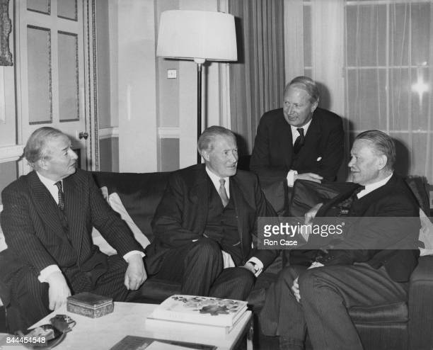From left to right Selwyn Lloyd Duncan Sandys Opposition Leader Edward Heath and Sir Hugh Beadle the Chief Justice of Rhodesia at Heath's flat in...