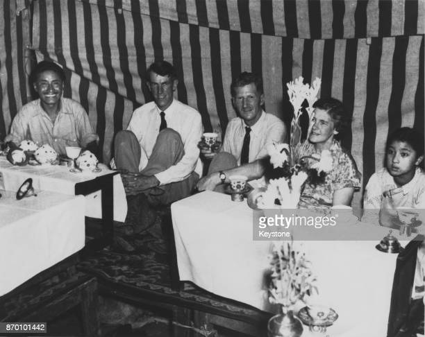 From left to right Sherpa Tenzing Norgay New Zealand explorer Sir Edmund Hillary English explorer John Hunt and his wife and another guest at a...