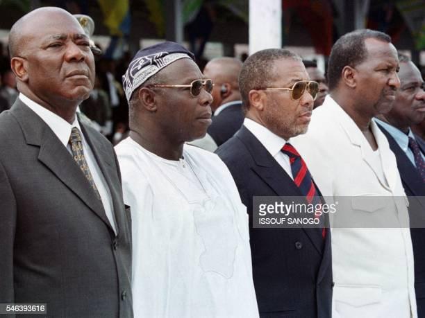 From left to right Sierra Leone's President Tejan Kabbah Nigeria's President Olusegun Obasanjo Liberia's President Charles Taylor and Mali's...