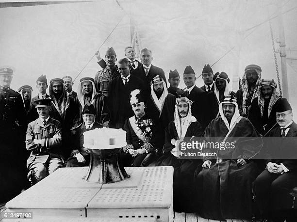 From left to right Sir Brooke Popham RAF Captain Bernard of the Inpin the High Commissioner King Faisal King Ibn Saud and Naji Pasha Suwaida King...