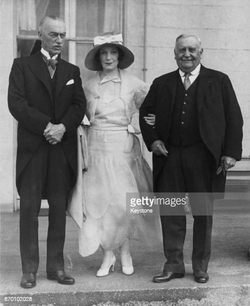 From left to right Sir Claude Hill Lieutenant Governor of the Isle of Man Lady Lavery and Senator Hennessey at the Viceregal Lodge in Dublin Ireland...
